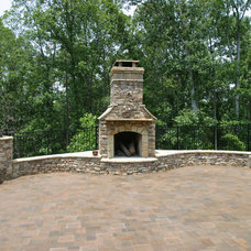 Traditional Patio by Artistic Landscapes
