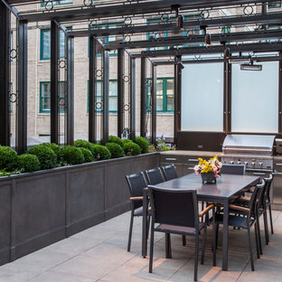 Elegant patio kitchen photo in Chicago with an awning