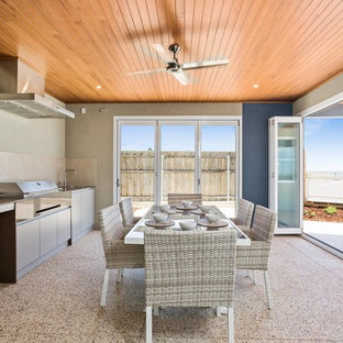 This is an example of a mid-sized beach style patio in Perth with an outdoor kitchen and a roof extension.