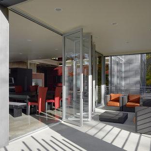 Patio - mid-sized contemporary backyard concrete patio idea in Cincinnati with a roof extension