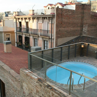 Immagine di una piccola piscina monocorsia minimal rotonda sul tetto con una dépendance a bordo piscina