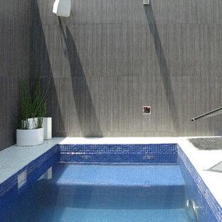 Modelo de piscinas y jacuzzis naturales, minimalistas, pequeños, rectangulares, en azotea, con gravilla