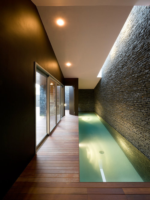 Example Of A Small Trendy Indoor Rectangular Pool Design In Other With  Decking