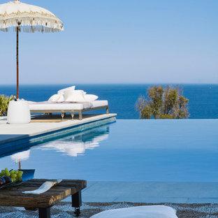 Foto de piscina infinita, marinera, rectangular