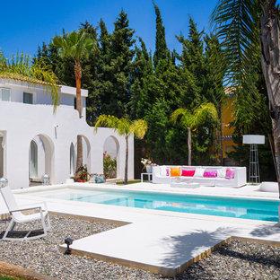Imagen de piscina mediterránea rectangular