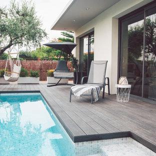 Inspiration för en liten funkis rektangulär pool framför huset