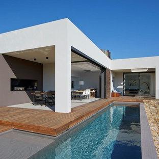 Inspiration pour une petit piscine avant minimaliste en L.