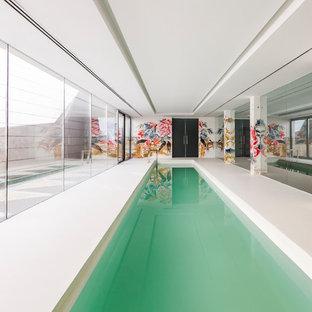 マドリードの長方形アジアンスタイルのおしゃれなプールの写真