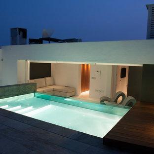 Diseño de casa de la piscina y piscina elevada, contemporánea, de tamaño medio, rectangular, en azotea