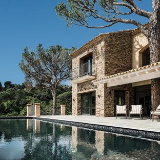 Imagen de casa de la piscina y piscina alargada, mediterránea, grande, rectangular