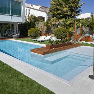 Foto de piscina actual, grande, en forma de L