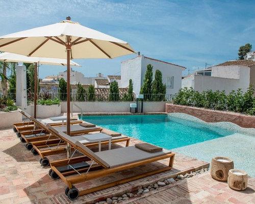 Fotos de piscinas dise os de piscinas con adoquines de for Diseno de patios con piscina