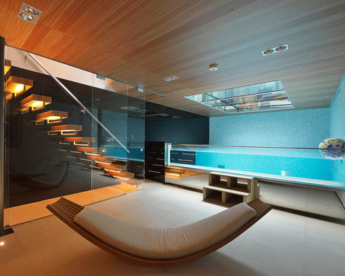 Example Of A Small Trendy Indoor Tile And Rectangular Aboveground Pool  Design In London With A