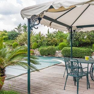 Idee per una piscina mediterranea dietro casa con pedane