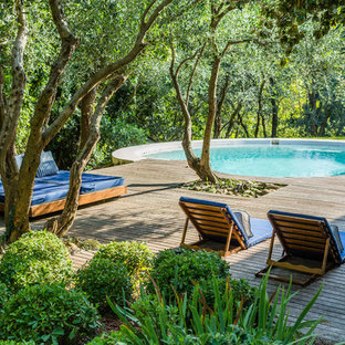 Example Of A Tuscan Backyard Round Pool Design In Bologna With Decking