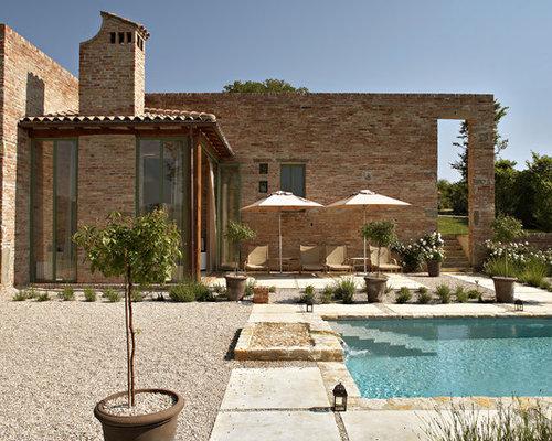 Foto e idee per piscine piscina con fontane - Fontana per piscina ...