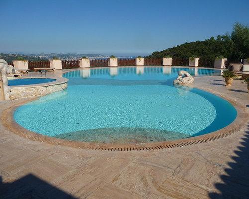piscine avec des pav s en pierre naturelle photos et id es d co de piscines. Black Bedroom Furniture Sets. Home Design Ideas