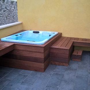 Modelo de piscinas y jacuzzis elevados, románticos, pequeños, a medida, en patio