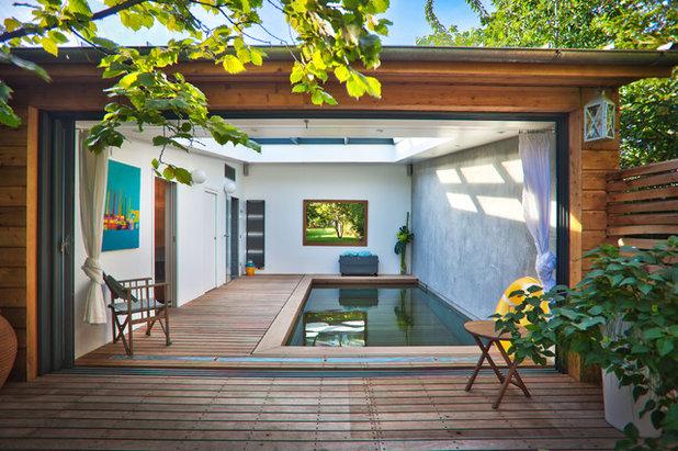 Versenkbarer pool wird zur terrasse per knopfdruck bers for Pool im boden
