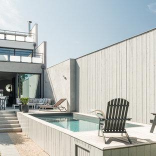 Inspiration pour une piscine sur une terrasse en bois hors-sol design rectangle.