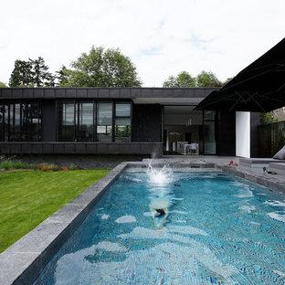 Idées déco pour un couloir de nage arrière contemporain de taille moyenne et rectangle.