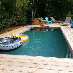 Ejemplo de piscina contemporánea, de tamaño medio, a medida