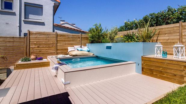 Une petite piscine dans un petit jardin urbain en for Margelle piscine toulouse