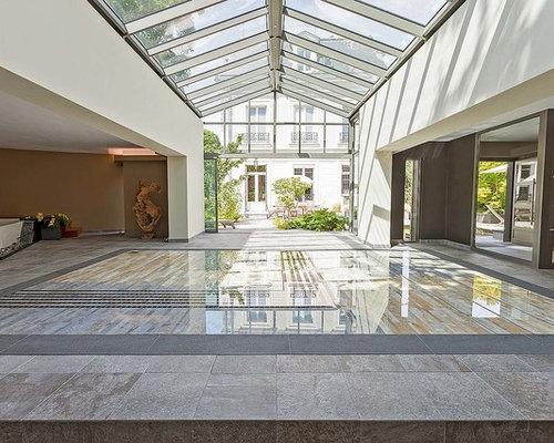 piscine int rieure avec des pav s en pierre naturelle photos et id es d co de piscines int rieures. Black Bedroom Furniture Sets. Home Design Ideas