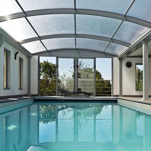 Exemple d'une grand piscine tendance rectangle.