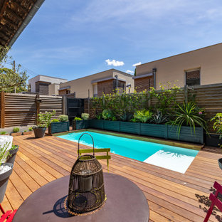 Mid-sized scandinavian side yard rectangular lap pool in Bordeaux with decking.