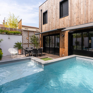 Design ideas for a small traditional courtyard l-shaped aboveground pool in Bordeaux with decking.