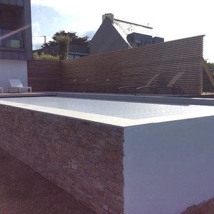 Idées déco pour une grand piscine sur une terrasse en bois hors-sol bord de mer rectangle.