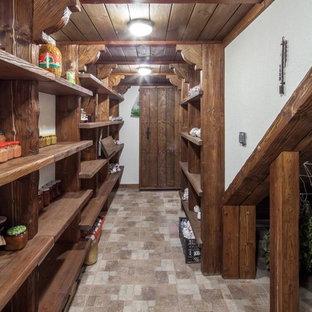 Новые идеи обустройства дома: подвал среднего размера в стиле кантри с белыми стенами, выходом наружу и полом из керамической плитки