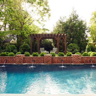 Traditional rectangular pool in Richmond with a water feature.