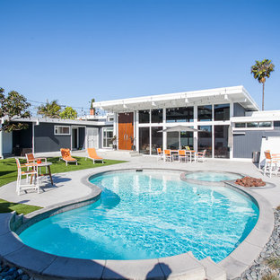 Inspiration for a 1950s backyard concrete paver and kidney-shaped hot tub remodel in Orange County