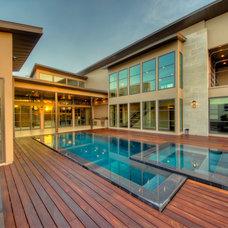 Contemporary Pool by Adam Wilson Custom Homes