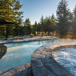 2016 Gold Award winner, vanishing edge concrete pool with spa and water feature