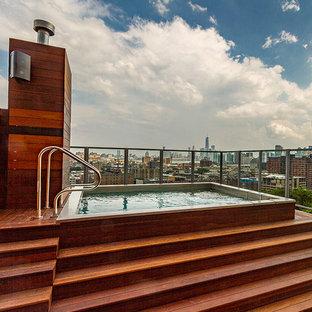 Imagen de piscinas y jacuzzis industriales, rectangulares, en azotea, con entablado