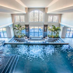 Foto de piscinas y jacuzzis alargados, clásicos renovados, grandes, interiores y rectangulares, con suelo de baldosas