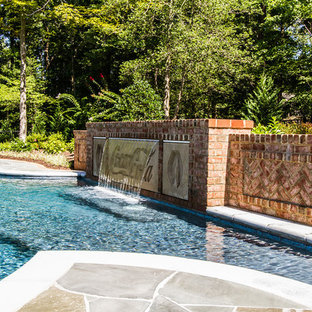 Inspiration for a large timeless backyard stone and kidney-shaped natural pool fountain remodel in Richmond