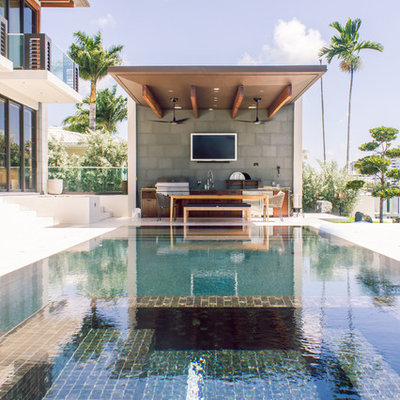 Inspiration for a contemporary rectangular pool remodel in Miami