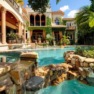 Tuscan backyard custom-shaped pool photo in Tampa