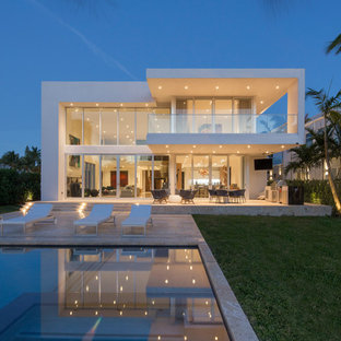 Inspiration for a contemporary backyard rectangular pool remodel in Miami