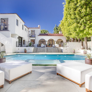 Inspiration for a large mediterranean backyard pool fountain remodel in Los Angeles