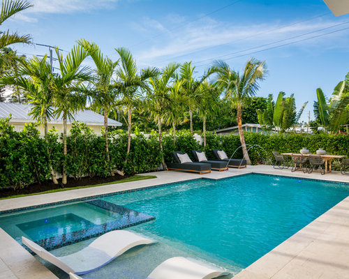 Island Style Backyard Tile And Rectangular Lap Pool Fountain Photo In Miami