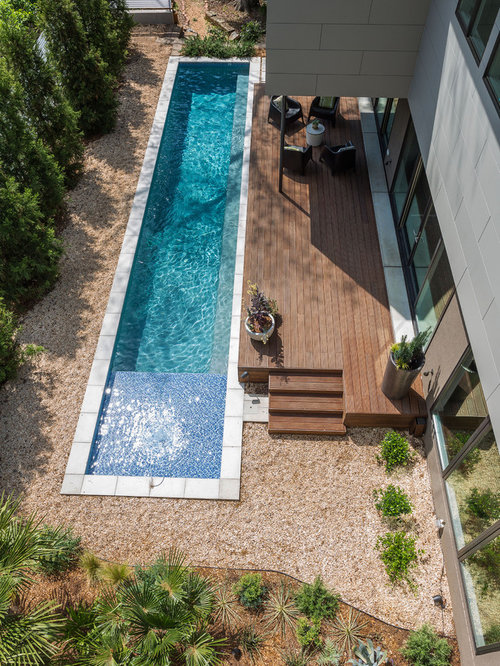 Mid Sized Trendy Backyard Rectangular Lap Pool Photo In Atlanta With Decking