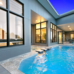 Contemporary backyard custom-shaped pool in Sunshine Coast with a hot tub and tile.