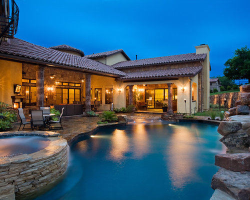 Elegant Large Mediterranean Backyard Stone And Custom Shaped Natural Hot Tub Idea  In Austin