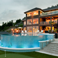 modern pool by Okanagan Dream Builders Ltd.