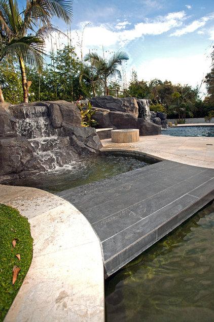 Mediterranean Pool by Mega Builders
